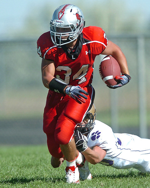 Loveland High School running back Josh Horst is tackled by Boulder's Abel Brown in the third quarter of their game on Saturday, Sept. 11, 2010 at Patterson Field. The Indians won, 13-7.