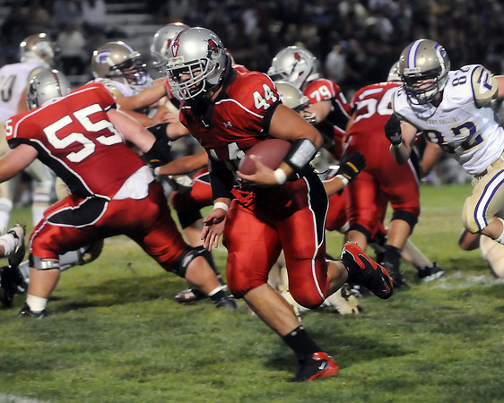 Loveland High School senior Connor Medbery makes a carry during a game against Fort Collins on Thursday, Sept. 2, 2010 at Patterson Stadium.