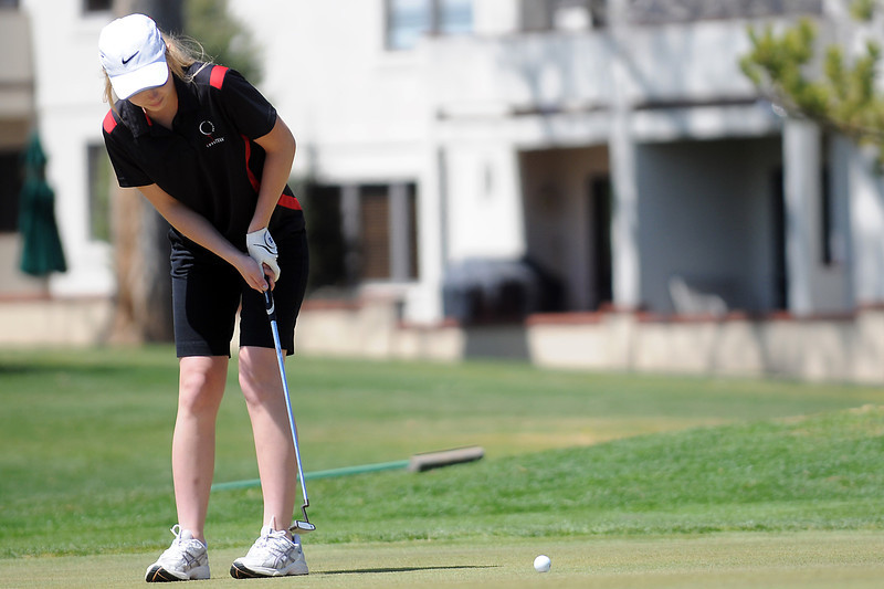 Loveland High School sophomore Kelsey Petersen hits a putt on hole No. 1 during a league meet Thursday, April 21, 2011 at The Olde Course.