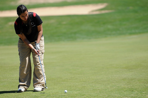 Loveland High School's Raquell Castillo watches her putt on No. 1 during the R2-J Invitational on Thursday, April 28, 2011 at Mariana Butte Golf Course.