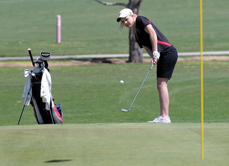 Loveland High School sophomore Kelsey Petersen chips onto the No. 5 green during a league meet Thursday, April 21, 2011 at The Olde Course.