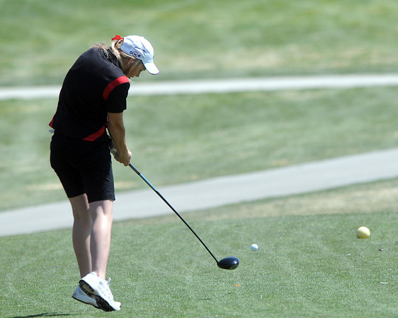 Loveland High School sophomore Kelsey Petersen hits her drive off the No. 6 tee box during a league meet Thursday, April 21, 2011 at The Olde Course.