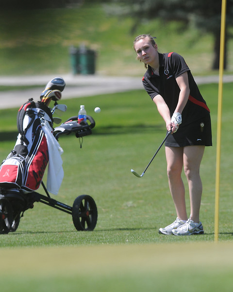 Loveland High School senior Alyssa Steine chips onto the No. 2 green during a league meet Thursday, April 21, 2011 at The Olde Course.
