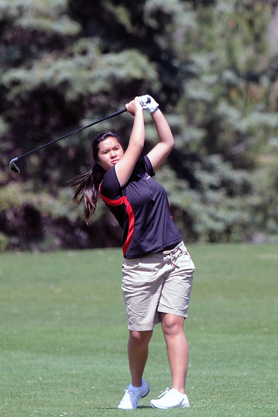 Loveland High School sophomore Raquell Castillo watches her fairway shot on hole No. 3 during a league meet Thursday, April 21, 2011 at The Olde Course.