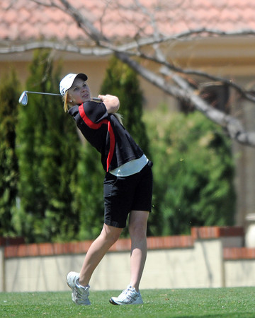 Loveland High School sophomore Kelsey Petersen watches her shot off the tee on No. 2 during a league meet Thursday, April 21, 2011 at The Olde Course.