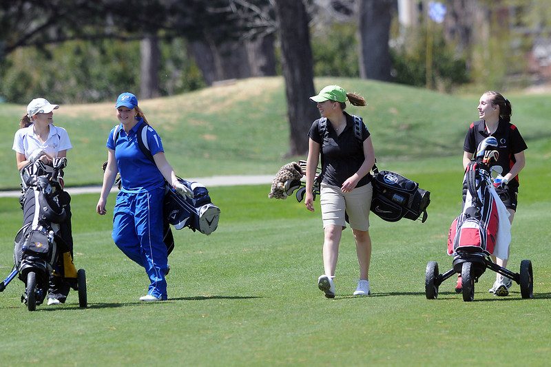 Loveland High School senior Alyssa Steine, right, walks with other golfers on the fairway of hole No. 2 during a league meet Thursday, April 21, 2011 at The Olde Course.