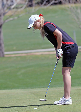 Loveland High School sophomore Kelsey Petersen taps in her putt on No. 5 during a league meet Thursday, April 21, 2011 at The Olde Course.