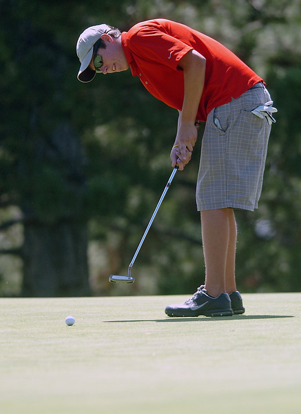 Loveland High School's Matt Stephens watches his putt on No. 3 while playing in a tournament Wednesday at The Olde Course.
