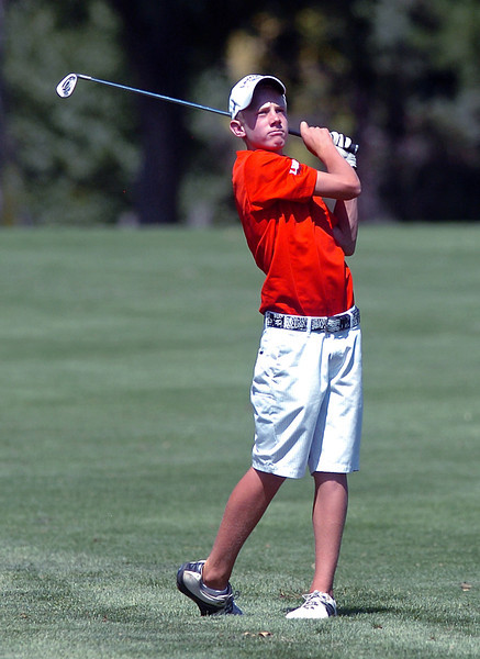 Loveland High School freshman Cole Bundy watches an approach shot while playing in a tournament Wednesday at The Olde Course at Loveland.