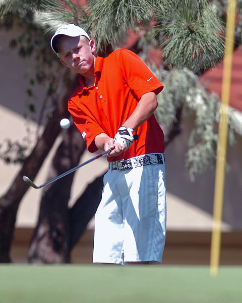 Loveland High School freshman Cole Bundy chips onto the No. 2 green while playing in a tournament Wednesday at The Olde Course.