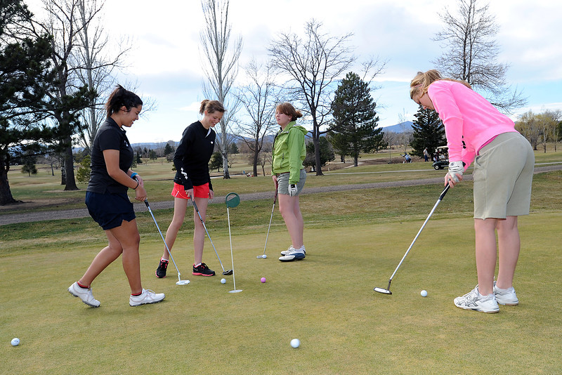 Members of Loveland High School's girls golf team spend time together on the putting green at The Olde Course at Loveland prior to heading out to play nine holes during practice on Friday, March 16, 2012. From left are junior Raquell Castillo, sophomore Aubrey Doran, junior Cristin Bogusz and junior Kelsey Petersen.