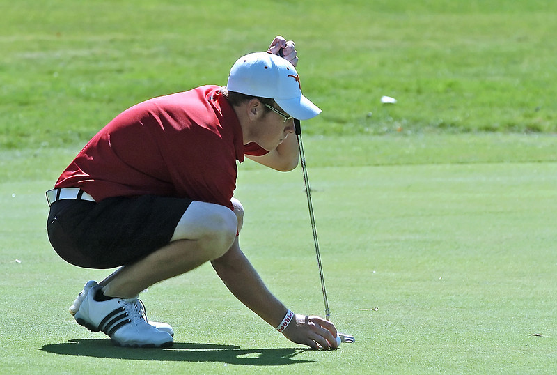 Loveland High School's Tanner Swayne lines up his putt on No. 18 while competing in the Class 5A Northern Regional at Coal Creek Golf Course in Louisville on Tuesday.