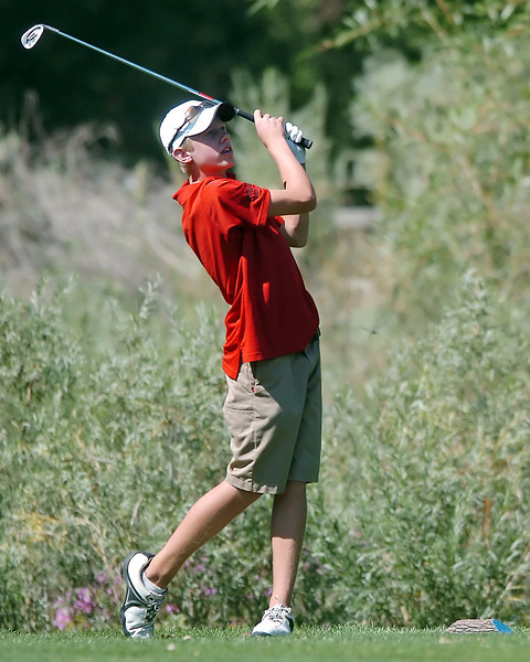 Loveland High School freshman Cole Bundy watches his drive off the No. 17 tee box Tuesday while competing in the Class 5A Northern Regional tournament at Coal Creek Golf Course in Louisville.