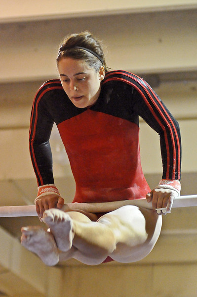 Loveland High School senior Jennifer Kuntz performs her routine on the uneven bars on Tuesday night during a meet at Thompson Valley High School.