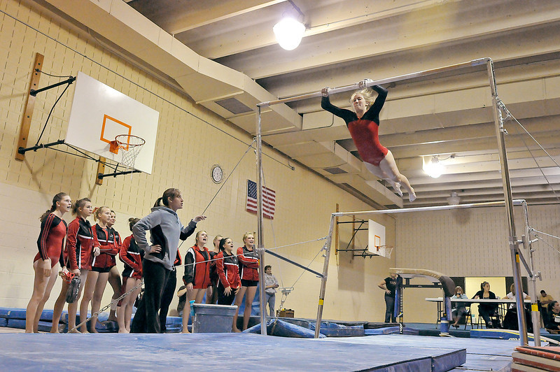 Loveland High School junior Jana Schmitt performs a routine on the uneven bars on Tuesday night at Thompson Valley High School.
