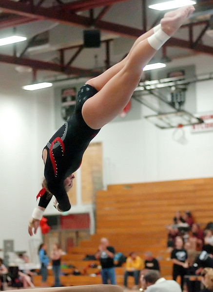Loveland High School's Jana Schmitt performs on the vault during a regional gymnastics meet on Friday at LHS.
