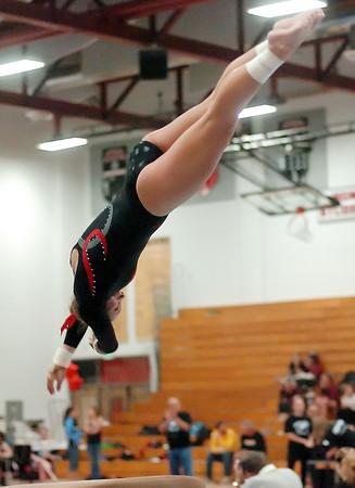 Loveland High School's Jana Schmitt performs on the vault during a regional gymnastics meet on Friday at LHS.
