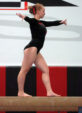 Loveland High School's Dayna Wadman performs on the balance beam during a regional gymnastics meet on Friday at LHS.