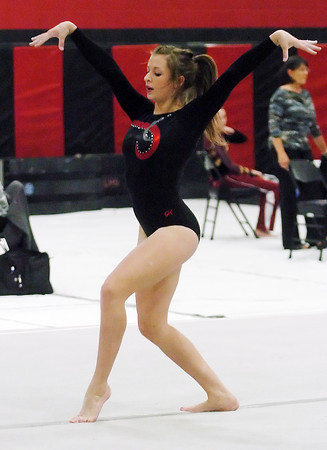 Loveland High School's Courtney Mills performs her floor routine during a regional gymnastics meet on Friday at LHS.