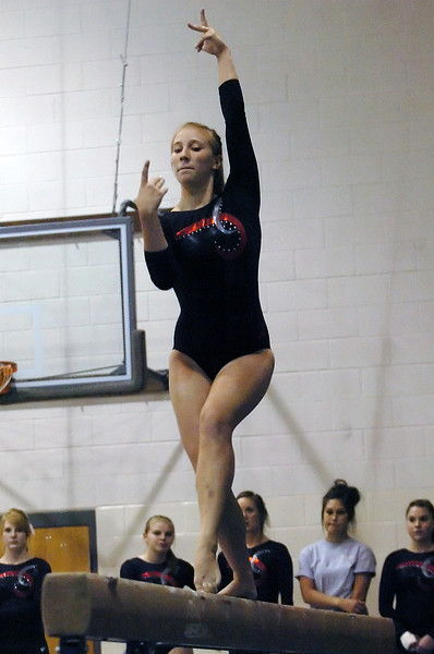 Loveland High School's Jana Schmitt performs on the balance beam Tuesday during a dual meet against Thompson Valley at LHS.