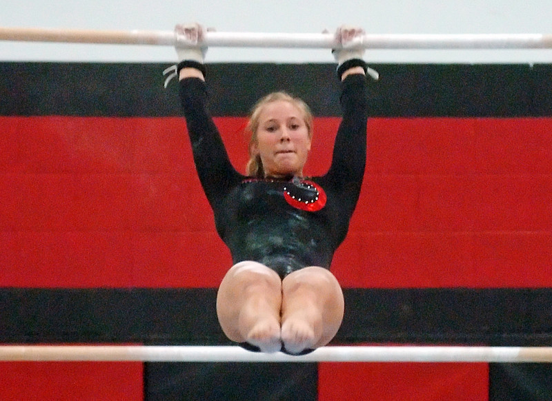 Loveland High School's Jana Schmitt competes on the uneven bars during a gymnastics meet Friday, Sept. 10, 2010 at LHS.