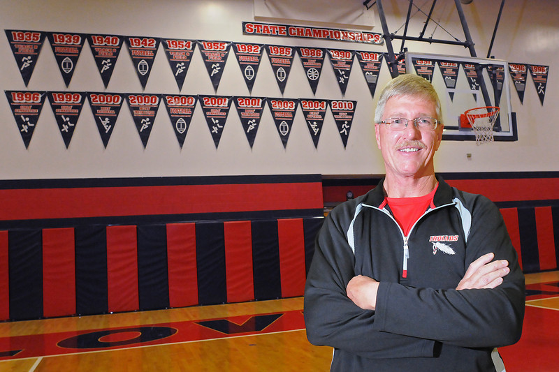 Loveland High School athletic director Devin Anderson poses Wednesday in the school's gymnasium. Anderson started working at Loveland in January 1979 as a teacher and is retiring from the school this year after a career that has also included coaching and his current role as athletic director.