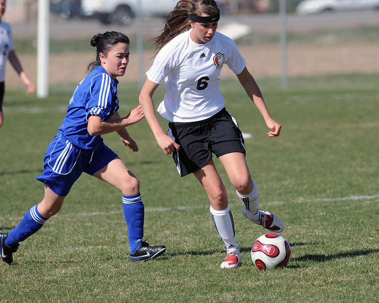 Loveland High School's Faith Winter (6) during a game against Thornton on Wednesday, April 14, 2010 at the Mountain View soccer field.