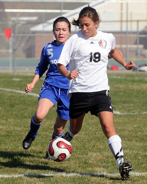 Loveland High School's Ashley Gleason (19) during a game against Thornton on Wednesday, April 14, 2010 at the Mountain View soccer field.