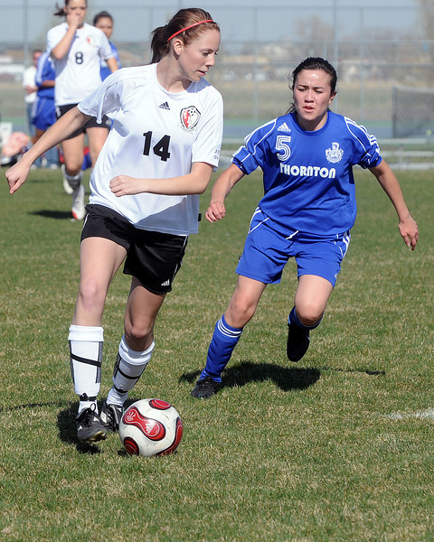 Loveland High School's Cristin DiCesare (14) during a game against Thornton on Wednesday, April 14, 2010 at the Mountain View soccer field.