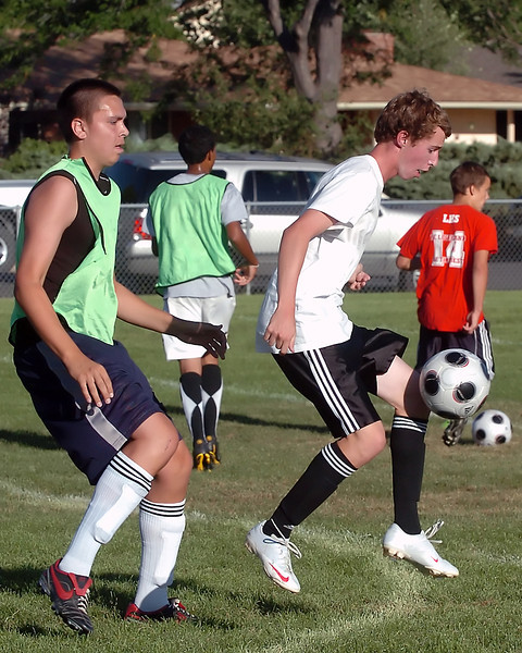 Loveland High School's Jim Etling, left, and Andrew Woodward work on a drill together during the soccer team's practice Wednesday evening outside the school.