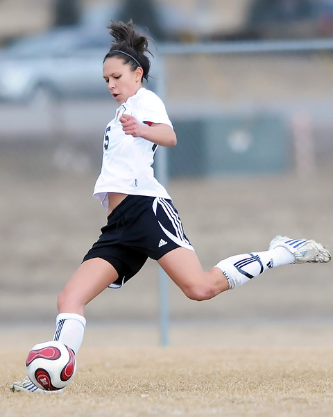 Loveland High School junior Moli Keeler makes a play during a game against Mountain View on Friday, March 5, 2010 at MVHS. Loveland won 4-1.