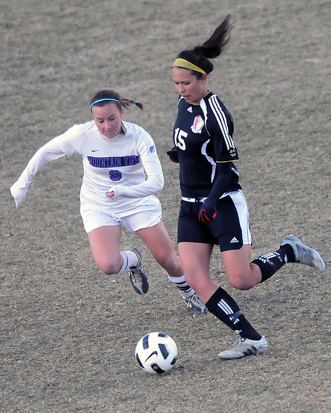 Loveland High School senior Moli Keeler, right, and Mountain View senior Kayla Grimes track down the ball in the second half of their game Tuesday, March 22, 2011 at Patterson Stadium. Keeler scored two goals in the Indians' 3-2 victory.