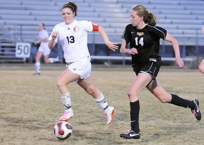 Thompson Valley High School sophomore Paige Chase, right, and Loveland's Lauren Sumner track down the ball in the first half of their game Tuesday night at Patterson Stadium. Chase would later score the game-winning goal in the second half of the Eagles' 2-1 victory over the Indians.