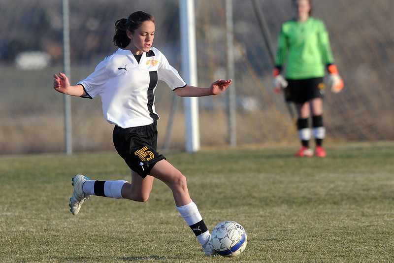 Thompson Valley High School defender Kendra Larson brings the ball upfield in the second half of a game against Loveland on Tuesday, March 20, 2012 at the Mountain View soccer field.