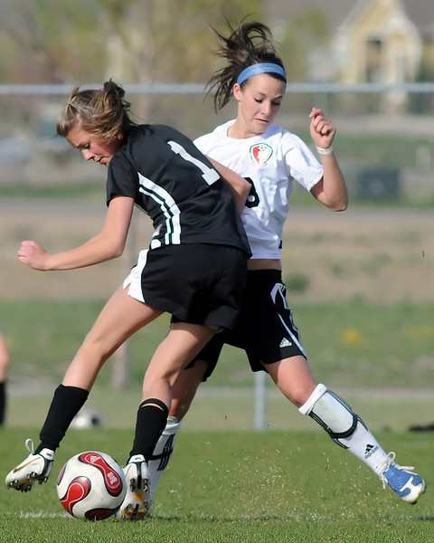 Loveland High School senior Ally Frickman, right, and Monarch's [NAME] battle for the ball in the second half of their game on Friday, May 7, 2010 at the Mountain View High School soccer field.