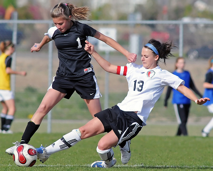 Loveland High School senior Ally Frickman, right, and Monarch's Courtney Richard battle for the ball in the second half of their game on Friday, May 7, 2010 at the Mountain View High School soccer field. Frickman added one goal in the Indians' 10-4 loss to the Coyotes.