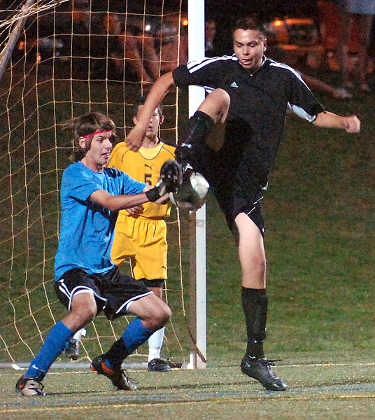 Thompson Valley's goalie Keegan Hand blocks a shot from Loveland High's #22 Irfan Farah Saturday.