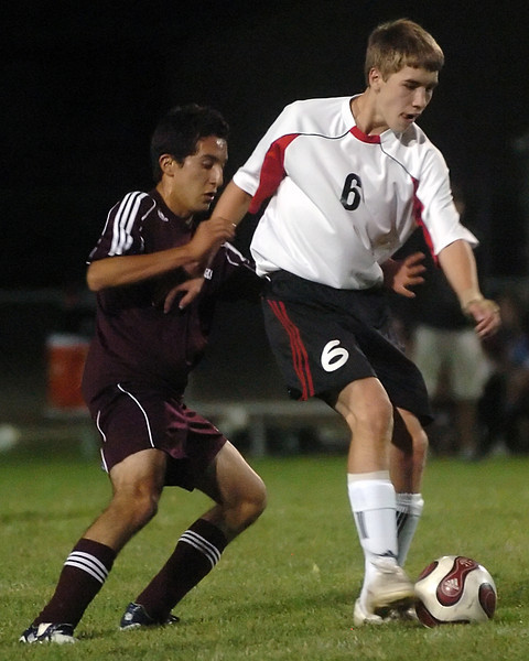 Loveland High School sophomore Brian Strasbaugh (6) battles with Berthoud's Axel Ayala for control of the ball in the first half of their game Monday at Patterson Stadium.