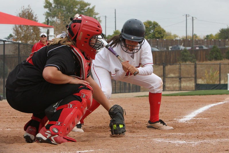 Loveland junior Anna Gerhard catches a low ball during their first game of the Colorado State Softball Championship October 22 2010 at Aurora Sports Park. <br /> Photo by Jenn LeBlanc