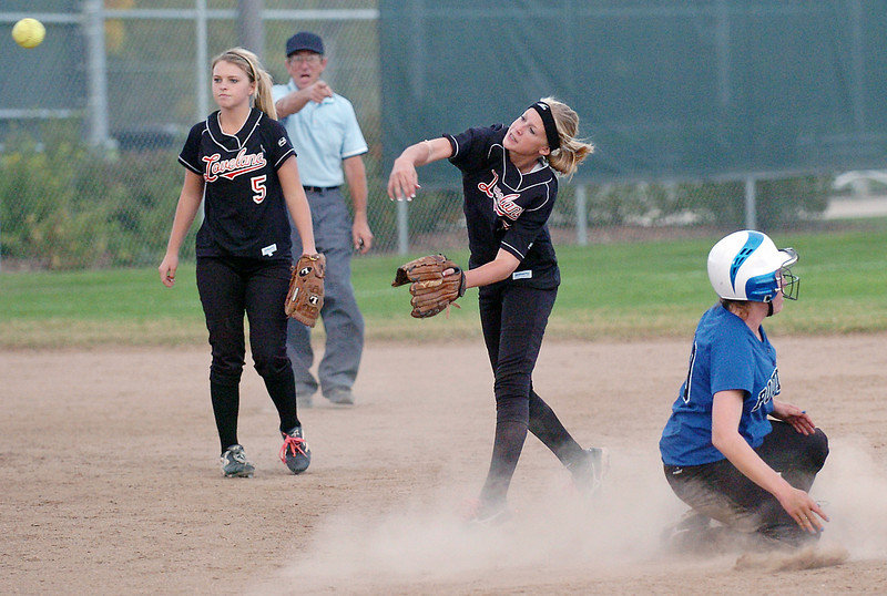Loveland High School second baseman Annika Anderson, center, makes a throw to first to complete a double play after getting Poudre baserunner Kasaundra Mascaranaz out at second while shortstop Bradey King (5) looks on. The Indians lost, 8-2.