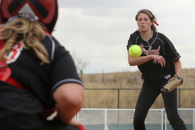 Loveland sophomore Cassidy Smith pitches and junior Anna Gerhard catches during their first game of the Colorado State Softball Championship October 22 2010 at Aurora Sports Park. Photo by Jenn LeBlanc