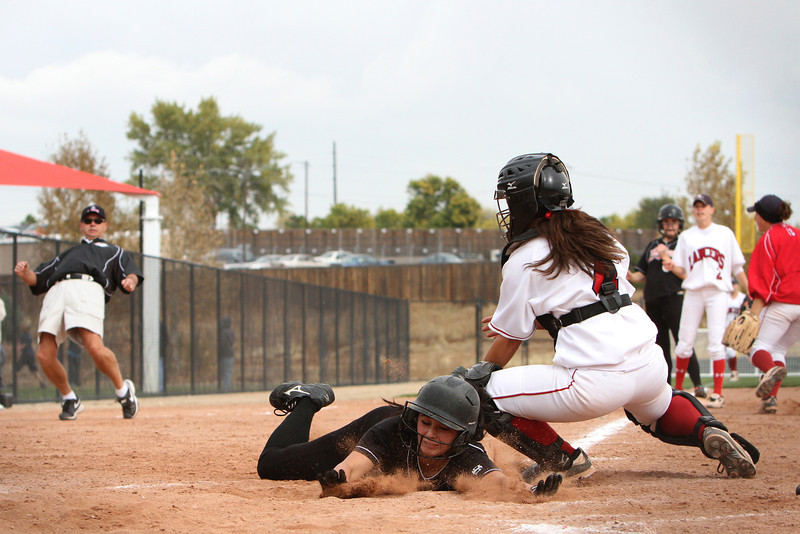 Loveland junior Alex Barleen #1 slides home, but is tagged out during their first game of the Colorado State Softball Championship October 22 2010 at Aurora Sports Park. <br /> Photo by Jenn LeBlanc