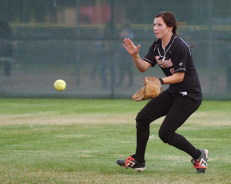 Loveland High School sophomore Colissa Bakovich makes a play on a ball hit to center field in the sixth inning of a game against Poudre on Tuesday at Centennial Field. The Indians lost, 8-2.