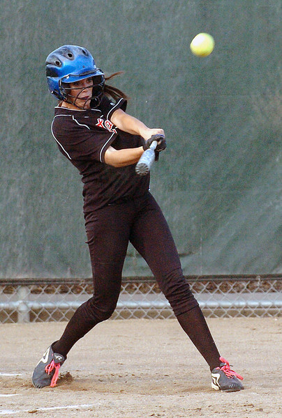 Loveland High School sophomore Cassidy Smith hits a triple in the bottom of the third inning of a game against Poudre on Tuesday at Centennial Field.