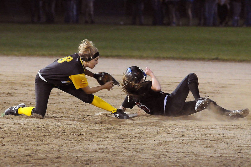 Junior Alexis Hunt of Thompson Valley High School tags out freshman Colissa Bakovich of Loveland High School during the 4th inning of Monday night's game at Centennial Field.