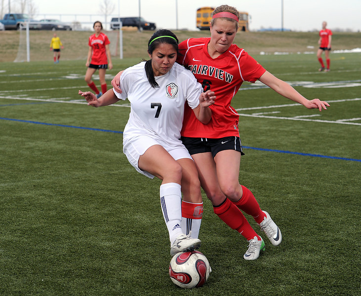 Loveland High School's #7 Greta Grainda, left, and Fairview High School's #6 Savanah Beetcher during their game at the Loveland Sports Park on Thursay, April 25, 2013.