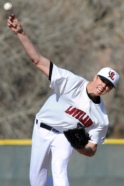 Loveland High School senior Alec Hansen throws a pitch during a game against Bear Creek on Thursday, April 4, 2013 at Centennial Field.