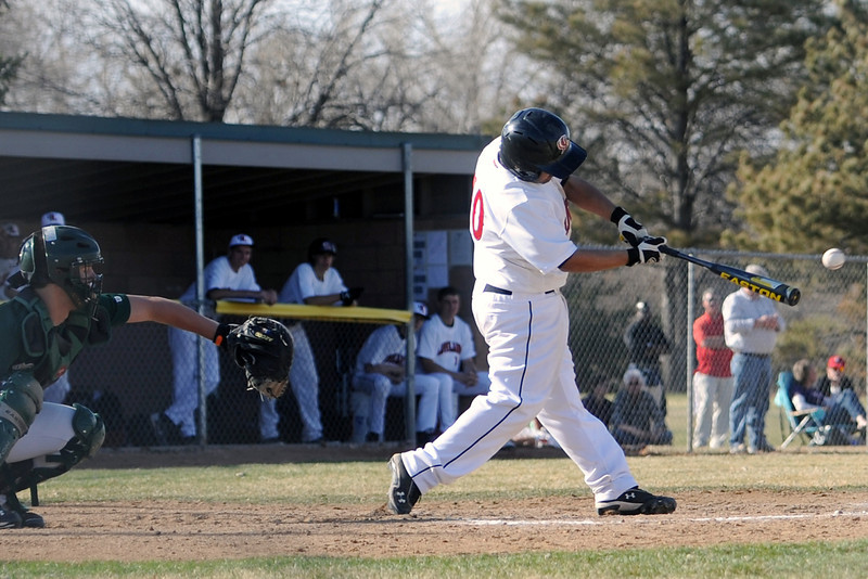 Loveland High School's Anthony Fernandez hits a single in front of Bear Creek catcher Alex DeBell in the bottom of the third inning of their game on Thursday, April 4, 2013 at Centennial Field.