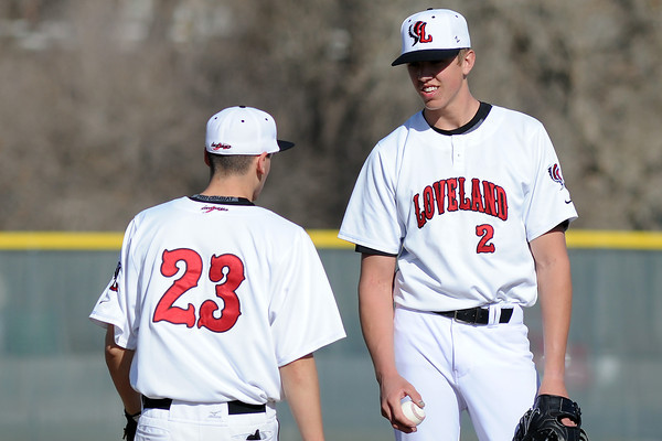 Loveland High School pitcher Alec Hansen, right, talks to third baseman K.C. Pomponio during a game against Bear Creek on Thursday, April 4, 2013 at Centennial Field.