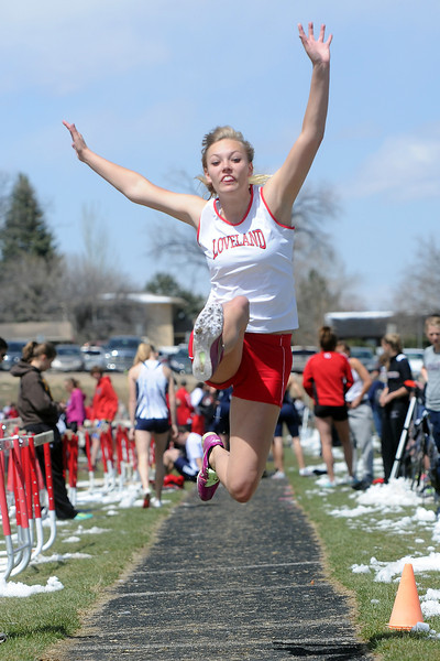 Loveland High School's Rae McCloughan competes in the long jump during the R2J Invitational meet on Wednesday, April 24, 2013 at LHS.